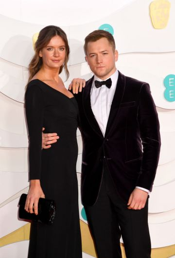 Emily Thomas and Taron Egerton attend the EE British Academy Film Awards 2020 at Royal Albert Hall on February 02, 2020 in London, England. (Photo by Dave J Hogan/Getty Images)