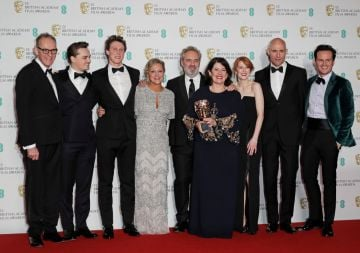 """(L to R)  Callum McDougall, Dean-Charles Chapman, George MacKay, Jayne-Ann Tenggren, Sir Sam Mendes, Dame Pippa Harris, Krysty Wilson-Cairns, Mark Strong and Andrew Scott, accepting the Best Film award for """"1917"""", pose in the Winners Room at the EE British Academy Film Awards 2020 at Royal Albert Hall on February 2, 2020 in London, England. (Photo by David M. Benett/Dave Benett/Getty Images)"""