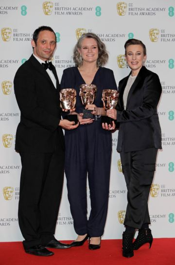 """(L to R)  Mark Jenkin, Linn Waite and Kate Byers, winners of Outstanding Debut By A British Writer, Director or Producer for """"Bait"""", pose in the Winners Room at the EE British Academy Film Awards 2020 at Royal Albert Hall on February 2, 2020 in London, England. (Photo by David M. Benett/Dave Benett/Getty Images)"""