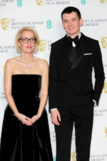 Gillian Anderson and Asa Butterfield pose in the Winners Room at the EE British Academy Film Awards 2020 at Royal Albert Hall on February 2, 2020 in London, England. (Photo by David M. Benett/Dave Benett/Getty Images)