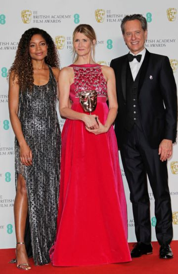 """(L to R)  Naomie Harris, Laura Dern, winner of Best Supporting Actress for """"Marriage Story"""", and Richard E. Grant pose in the Winners Room at the EE British Academy Film Awards 2020 at Royal Albert Hall on February 2, 2020 in London, England. (Photo by David M. Benett/Dave Benett/Getty Images)"""