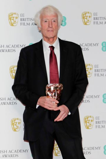 """Roger Deakins, winner of the Best Cinematography award for """"1917"""", poses in the Winners Room at the EE British Academy Film Awards 2020 at Royal Albert Hall on February 2, 2020 in London, England. (Photo by David M. Benett/Dave Benett/Getty Images)"""