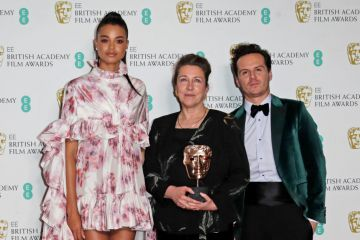 """Ella Balinska, Jacqueline Durran, winner of Best Costume Design for """"Little Women"""", and Andrew Scott pose in the Winners Room at the EE British Academy Film Awards 2020 at Royal Albert Hall on February 2, 2020 in London, England. (Photo by David M. Benett/Dave Benett/Getty Images)"""