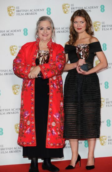 """Carol Dysinger and Elena Andreicheva, winners of the Best British Short Film award for """"Learning to Skateboard in a Warzone (If You're a Girl)"""", pose in the Winners Room at the EE British Academy Film Awards 2020 at Royal Albert Hall on February 2, 2020 in London, England. (Photo by David M. Benett/Dave Benett/Getty Images)"""