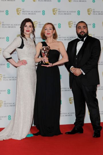 """(L to R)  Aisling Bea, Anne Morgan, winner of Best Make-Up and Hair for """"Bombshell"""", and Asim Chaudhry aka Chabuddy G pose in the Winners Room at the EE British Academy Film Awards 2020 at Royal Albert Hall on February 2, 2020 in London, England. (Photo by David M. Benett/Dave Benett/Getty Images)"""
