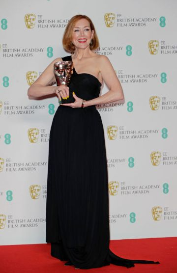 """Anne Morgan, winner of Best Make-Up and Hair for """"Bombshell"""", poses in the Winners Room at the EE British Academy Film Awards 2020 at Royal Albert Hall on February 2, 2020 in London, England. (Photo by David M. Benett/Dave Benett/Getty Images)"""