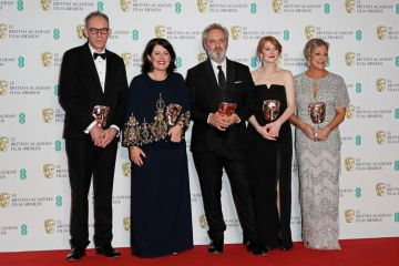 """(L to R)  Callum McDougall, Dame Pippa Harris, Sir Sam Mendes, Krysty Wilson-Cairns and Jayne-Ann Tenggren, winners of the Outstanding British Film award for """"1917"""", pose in the Winners Room at the EE British Academy Film Awards 2020 at Royal Albert Hall on February 2, 2020 in London, England. (Photo by David M. Benett/Dave Benett/Getty Images)"""