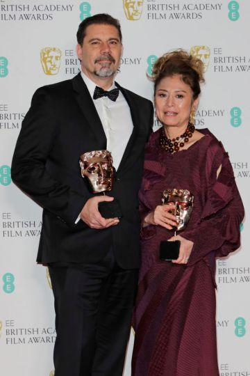 """Sergio Pablos and Jinko Gotoh, winners of the Best Animation award for """"Klaus"""", pose in the Winners Room at the EE British Academy Film Awards 2020 at Royal Albert Hall on February 2, 2020 in London, England. (Photo by David M. Benett/Dave Benett/Getty Images)"""