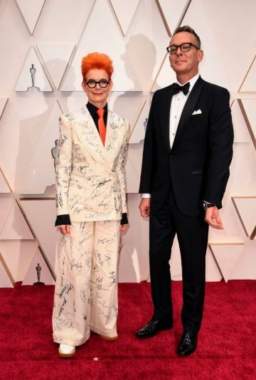 British costume designer Sandy Powell and a guest arrive for the 92nd Oscars at the Dolby Theatre in Hollywood, California on February 9, 2020. (Photo by Robyn Beck / AFP) (Photo by ROBYN BECK/AFP via Getty Images)