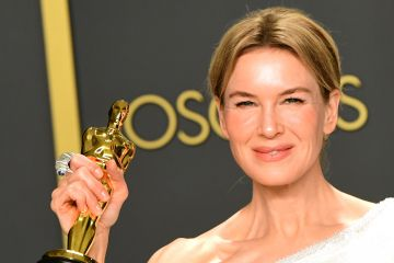 """US actress Renee Zellweger poses in the press room with the Oscar for for Best Actress for """"Judy"""" during the 92nd Oscars at the Dolby Theater in Hollywood, California on February 9, 2020. (Photo by FREDERIC J. BROWN / AFP) (Photo by FREDERIC J. BROWN/AFP via Getty Images)"""