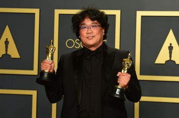 """South Korean director Bong Joon-ho poses in the press room with the Oscars for """"Parasite"""" during the 92nd Oscars at the Dolby Theater in Hollywood, California on February 9, 2020. - Bong Joon-ho won for Best Director, Best Movie, Best International Feature Film and Best Original Screenplay for """"Parasite"""". (Photo by FREDERIC J. BROWN / AFP) (Photo by FREDERIC J. BROWN/AFP via Getty Images)"""