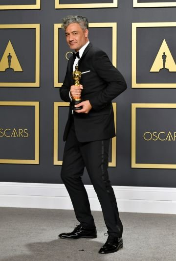"""Director Taika Waititi, winner of the Adapted Screenplay award for """"Jojo Rabbit,"""" poses in the press room during the 92nd Annual Academy Awards at Hollywood and Highland on February 09, 2020 in Hollywood, California. (Photo by Amy Sussman/Getty Images)"""