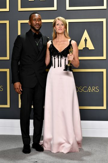 """Mahershala Ali (L) with Laura Dern, winner of the Actress in a Supporting Role award for """"Marriage Story,"""" poses in the press room during the 92nd Annual Academy Awards at Hollywood and Highland on February 09, 2020 in Hollywood, California. (Photo by Amy Sussman/Getty Images)"""