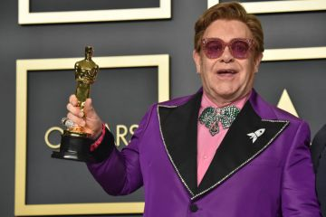 """Musician Elton John, winner of the Original Song award for """"(I'm Gonna) Love Me Again"""" from """"Rocketman,"""" poses in the press room during the 92nd Annual Academy Awards at Hollywood and Highland on February 09, 2020 in Hollywood, California. (Photo by Jeff Kravitz/FilmMagic)"""