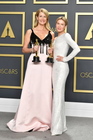"""Laura Dern, winner of the Actress in a Supporting Role award for """"Marriage Story,""""  and Renée Zellweger, winner of the Actress in a Leading Role award for """"Judy,"""" pose in the press room during the 92nd Annual Academy Awards at Hollywood and Highland on February 09, 2020 in Hollywood, California. (Photo by Amy Sussman/Getty Images)"""