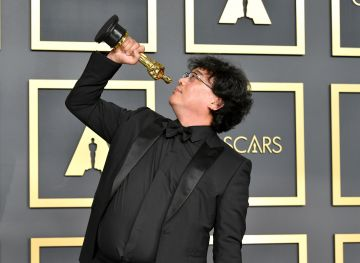 """Director Bong Joon-ho, winner of the Original Screenplay, International Feature Film, Directing, and Best Picture  award for """"Parasite,"""" poses in the press room during the 92nd Annual Academy Awards at Hollywood and Highland on February 09, 2020 in Hollywood, California. (Photo by Amy Sussman/Getty Images)"""