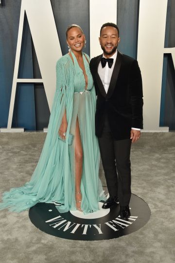 Chrissy Teigen and John Legend attend the 2020 Vanity Fair Oscar Party at Wallis Annenberg Center for the Performing Arts on February 09, 2020 in Beverly Hills, California. (Photo by David Crotty/Patrick McMullan via Getty Images)