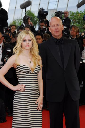 """2006: Anne Avril Lavignes and Bruce Willis during 2006 Cannes Film Festival - """"Over The Hedge"""" - Premiere at Palais des Festival in Cannes, France. (Photo by Foc Kan/WireImage)"""