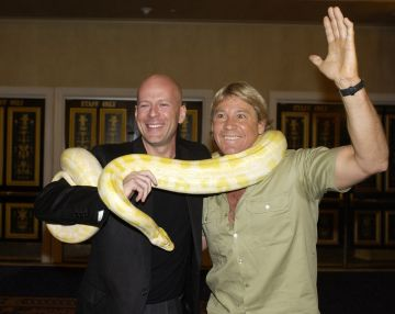 2002: Bruce Willis and Steve Irwin, The Crocodile Hunter (Photo by Denise Truscello/WireImage)
