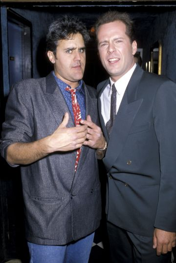 1986: Jay Leno and Bruce Willis (Photo by Jim Smeal/Ron Galella Collection via Getty Images)