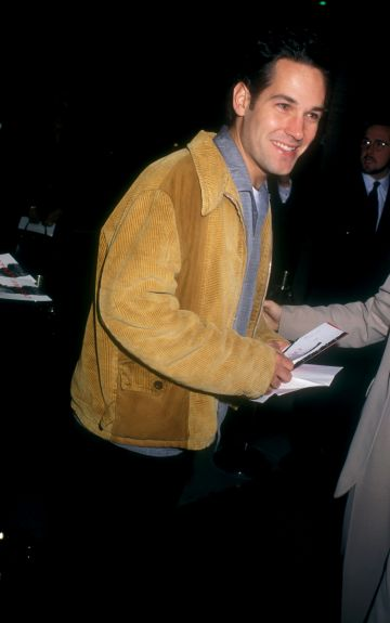 1996: Paul Rudd signs autographs outside the premiere of The Crucible. (Photo by Barry King/WireImage)