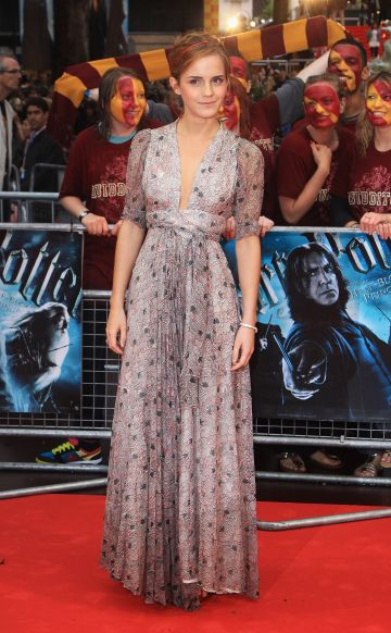 Emma Watson arrives as the rain pours down at the World Premiere of Harry Potter And The Half Blood Prince at Empire Leicester Square on July 7, 2009 in London, England.  (Photo by Tim Whitby/Getty Images)