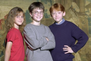 Warner Bros. Pictures announced August 21, 2000 that the young actor Daniel Radcliffe, center, has been named as the young actor who will play Harry Potter, in the upcoming film adaptation of the popular books by J.K. Rowling. Newcomers Rupert Grint, right, and Emma Watson will be taking on the roles of Ron and Hermione, Harry's best friends at Hogwarts. (Courtesy of Warner Bros./Newsmakers)