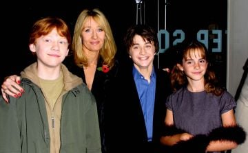 Actors Rupert Grint, Author JK Rowling, Daniel Radcliffe and Emma Watson attend the world premiere of the first Harry Potter film, 'Harry Potter and the Philosopher's Stone' at the Odeon Leicester Square, London, November 4, 2001. (Photo by Gareth Davies/Getty Images)