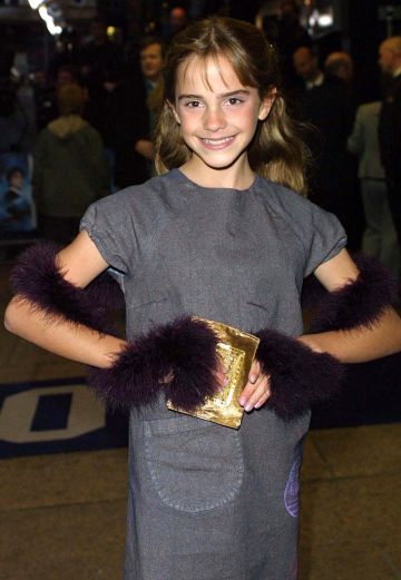 "Actress Emma Watson arrives at the premiere of ""Harry Potter and the Philosopher's Stone"" November 4, 2001 in London. (Photo by UK Press/Getty Images)"