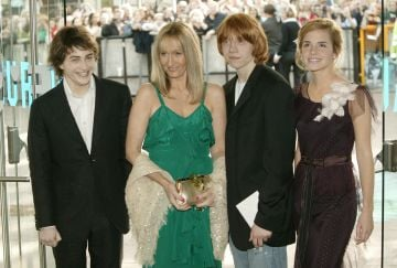 "Actor Daniel Radcliffe writer J K Rowling and actors Rupert Grint and Emma Watson attend the UK Premiere of ""Harry Potter And The Prisoner Of Azkaban"" at the Odeon Leicester Square on May 30, 2004 in London. The film is the third celluloid instalment of J K Rowling's series of books. (Photo by Dave Hogan/Getty Images)"