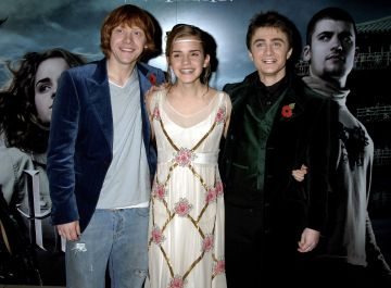 "Actors Rupert Grint, Emma Watson and Daniel Radcliffe arrive at the World Premiere of ""Harry Potter And The Goblet Of Fire"" at the Odeon Leicester Square on November 6, 2005 in London, England.  The film is based on the fourth installment of author J.K. Rowling's novel series.  (Photo by Dave M. Benett/Getty Images)"