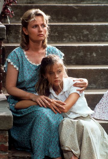 Reese Witherspoon started her career at age 14 with the film 'The Man in The Moon' in 1991.  Pictured: Tess Harper comforts Reese Witherspoon in a scene from the film 'The Man In The Moon', 1991. (Photo by Metro-Goldwyn-Mayer/Getty Images)