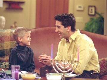 "Actors Cole Sprouse) as Ben and David Schwimmer as Ross Geller star in NBC's comedy series ""Friends"" episode ""The One with the Holiday Armadillo."" Ross has Ben for the holidays and decides that this season, they will celebrate Chanukah instead of Christmas. (Photo by Warner Bros. Television)"