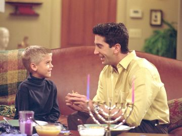 """Actors Cole Sprouse) as Ben and David Schwimmer as Ross Geller star in NBC's comedy series """"Friends"""" episode """"The One with the Holiday Armadillo."""" Ross has Ben for the holidays and decides that this season, they will celebrate Chanukah instead of Christmas. (Photo by Warner Bros. Television)"""