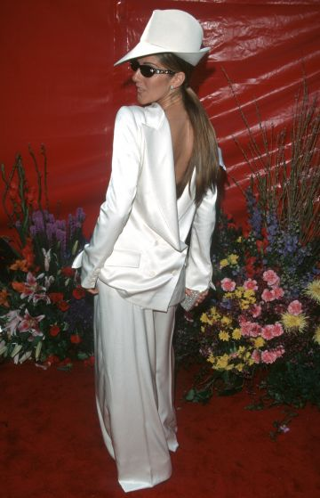 Celine Dion pictued at the 71st Annual Academy Awards. Dion opted to wear her suit jacket backwards, causing a stir on the red carpet. (Photo by Jim Smeal/Ron Galella Collection via Getty Images)