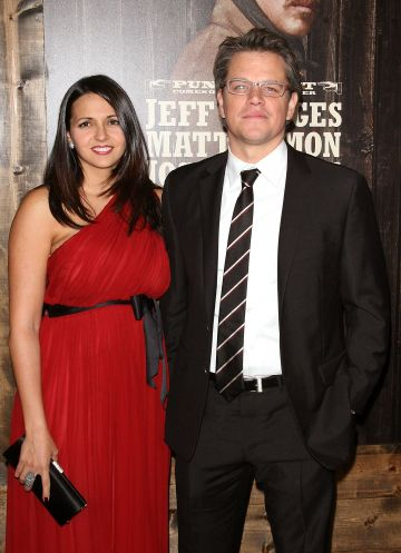 """2010:  Actor Matt Damon (R) and wife Luciana Damon attend the premiere of """"True Grit"""" at the Ziegfeld Theatre on December 14, 2010 in New York City.  (Photo by Jim Spellman/WireImage)"""