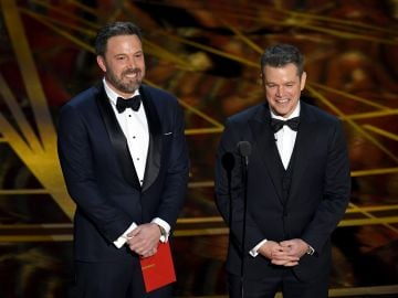 2017:  Actor/director Ben Affleck (L) and actor/producer Matt Damon speak onstage during the 89th Annual Academy Awards at Hollywood & Highland Center on February 26, 2017 in Hollywood, California.  (Photo by Kevin Winter/Getty Images)