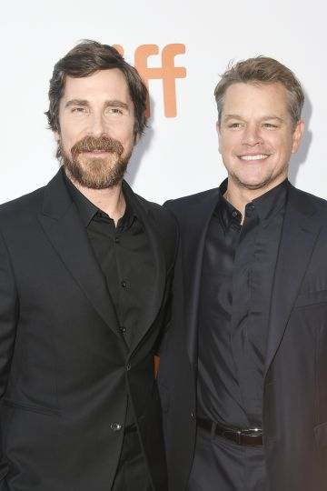 """2019:  (L-R) Christian Bale and Matt Damon attend the """"Ford v Ferrari"""" premiere during the 2019 Toronto International Film Festival at Roy Thomson Hall on September 09, 2019 in Toronto, Canada. (Photo by Frazer Harrison/Getty Images)"""