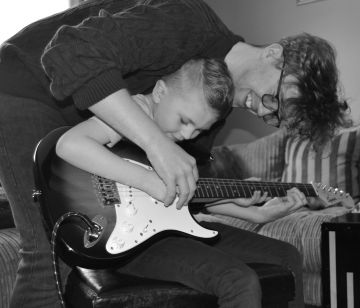 Taken in Dublin.  'Every pro was once an amateur. Big bro teaching his little bro'.  By rebecca K.