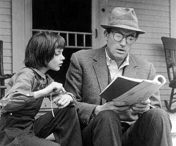 American actor Gregory Peck portrayed Atticus FInch, the wise and respectful single father of two in To Kill A Mockingbird (1962). Photo by Universal Studios/Getty Images)/ All Rights Reserved.