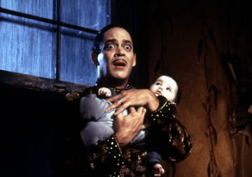 Portrayed by multiple actors over the years, Gomez Addams always appears as the caring and positive male role model in his kids lives. (Pictured is Raul Julia from Addams Family Values in 1993). @Paramount Pictures. All Rights Reserved.