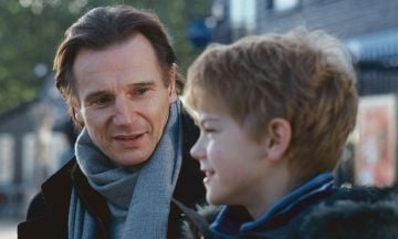 Liam Neeson makes the list for a second time with his unique role as grieving stepfather Daniel in Love Actually. @Universal Pictures. All Right Reserved.