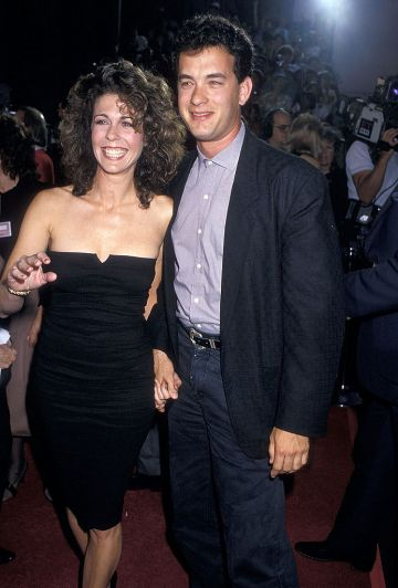 """1987: Actress Rita Wilson and actor Tom Hanks attend the """"Dragnet"""" Hollywood Premiere on June 23, 1987 at the Pacific's Paramount Theatre in Hollywood, California. (Photo by Ron Galella, Ltd./Ron Galella Collection via Getty Images)"""
