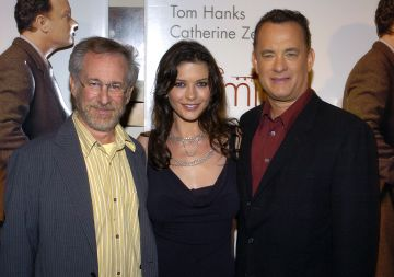 2004: Steven Spielberg, Catherine Zeta-Jones and Tom Hanks pictured at the world premiere of The Terminal. (Photo by L. Cohen/WireImage)