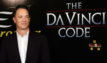 """2006:  Tom Hanks and the other stars of """"The Da Vinci Code"""" arrived in Cannes ahead of an exclusive preview screening of the movie version of the bestselling novel by Dan Brown. (Photo: VALERY HACHE/AFP via Getty Images)"""