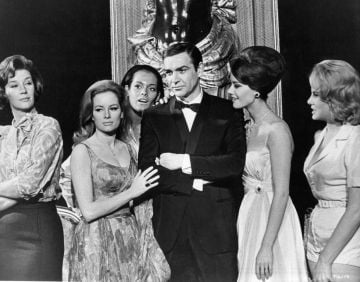 Actor Sean Connery with (left to right), Lois Maxwell, Luciana Paluzzi, Martine Beswick, Claudine Auger and Molly Peters, his female co-stars from the film 'Thunderball', 1965. (Photo by United Artists/Getty Images)
