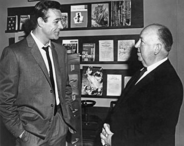 Scottish actor Sean Connery (left) and English director Alfred Hitchcock (1899 - 1980) discussing their thriller, 'Marnie', which is in production in Hollywood, February 1964. (Photo by Photoshot/Keystone/Hulton Archive/Getty Images)