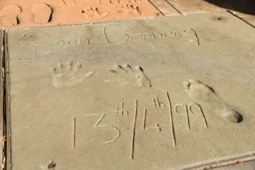Sean Connery's handprints and footprints from a 1999 ceremony are displayed at the TCL Chinese Theatre on October 31, 2020 in Hollywood, California. The Scottish actor, Sir Sean Connery who was best known for his portrayal of James Bond, died in his sleep in the Bahamas at the age of 90. (Photo by Rich Fury/Getty Images)