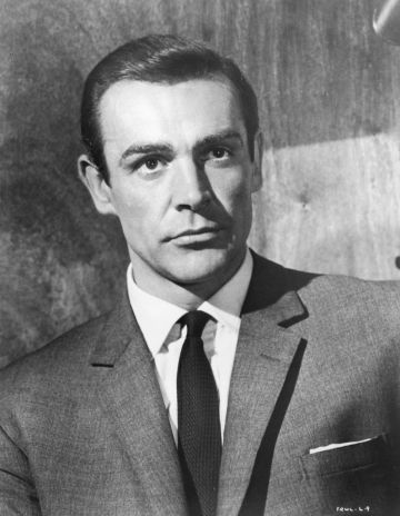 1963:  Scottish actor Sean Connery wears a suit jacket and a tie as James Bond in a still from director Terence Young's film, 'From Russia with Love'.  (Photo by Hulton Archive/Getty Images)