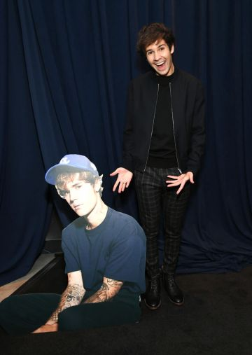 David Dobrik pictured with Justin Beiber cardboard cutout at the 2020 American Music Awards at Microsoft Theater on November 22, 2020 in Los Angeles, California. (Photo by Kevin Mazur/AMA2020/Getty Images for dcp)